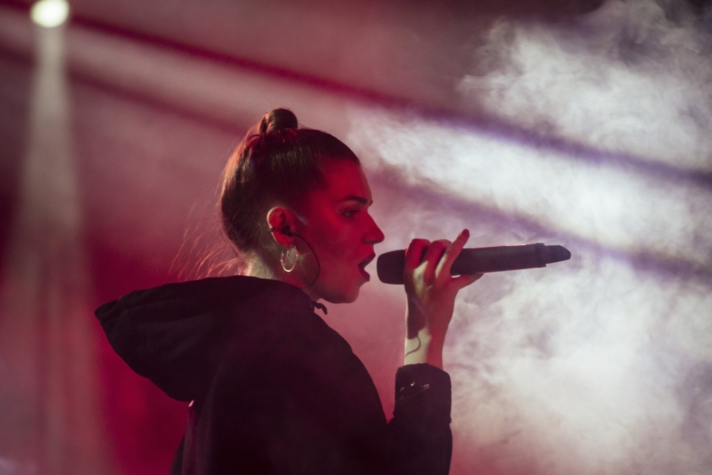 In this photo taken on Thursday, Nov. 29, 2018, Russian musician Nastya Kreslina, member of electronic duo called IC3PEAK performs during a concert in