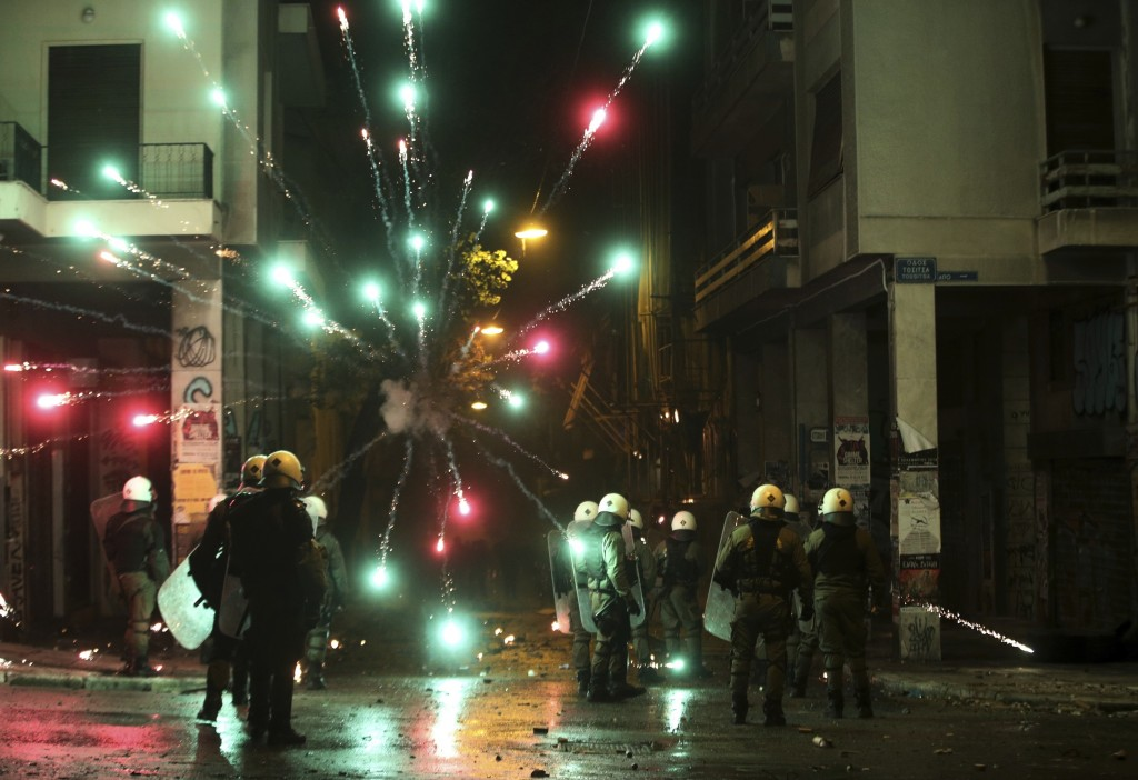 Protesters use fireworks against riot police during clashes in the Athens neighborhood of Exarchia, a haven for extreme leftists and anarchists, Thurs
