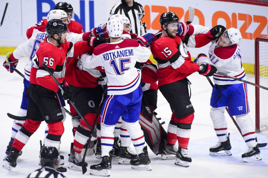 Tempers flare as the Ottawa Senators take on the Montreal Canadiens during third-period NHL hockey game action in Ottawa, Ontario, Thursday, Dec. 6, 2