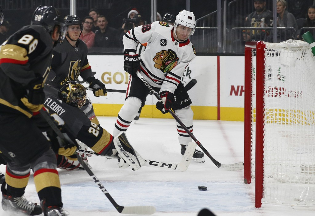Chicago Blackhawks right wing Patrick Kane (88) passes behind Vegas Golden Knights goaltender Marc-Andre Fleury (29) during the first period of an NHL
