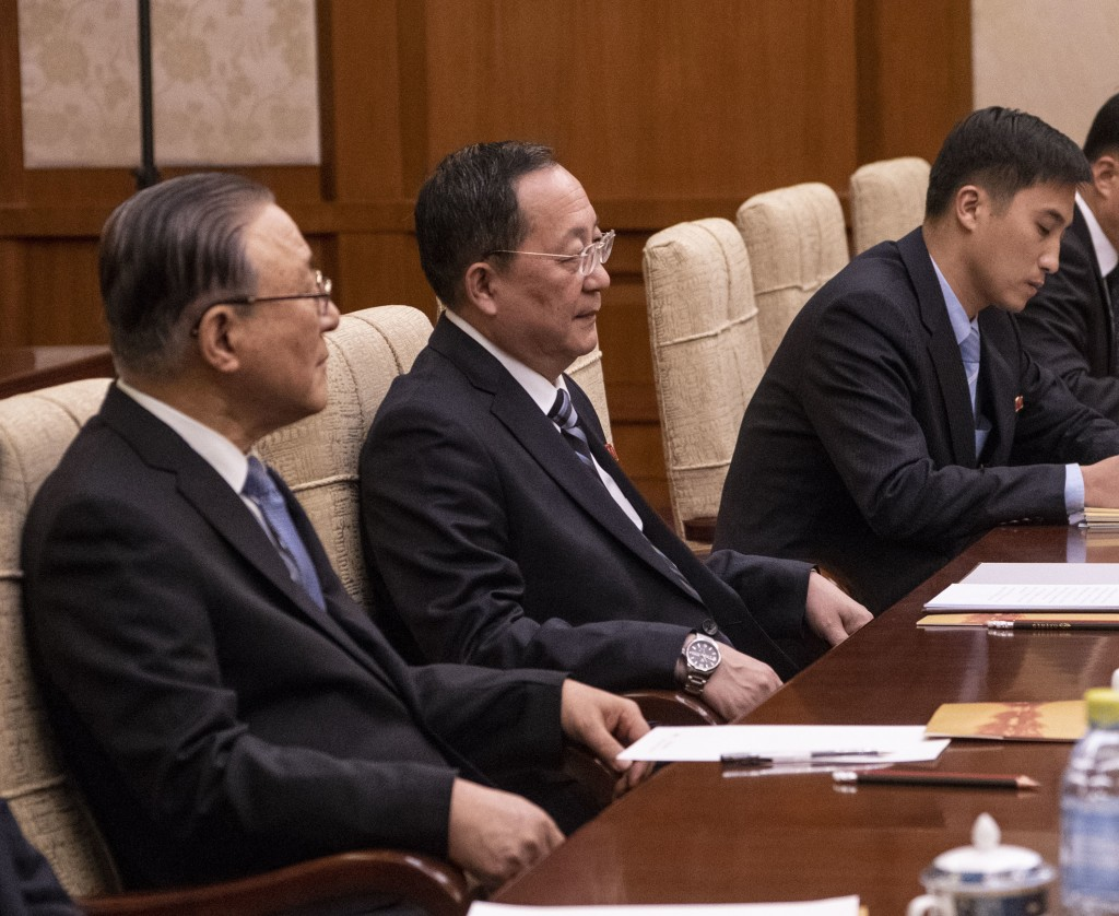 North Korean Foreign Minister Ri Yong Ho, center, listens to China's Foreign Minister Wang Yi during a meeting at the Diaoyutai State Guesthouse in Be
