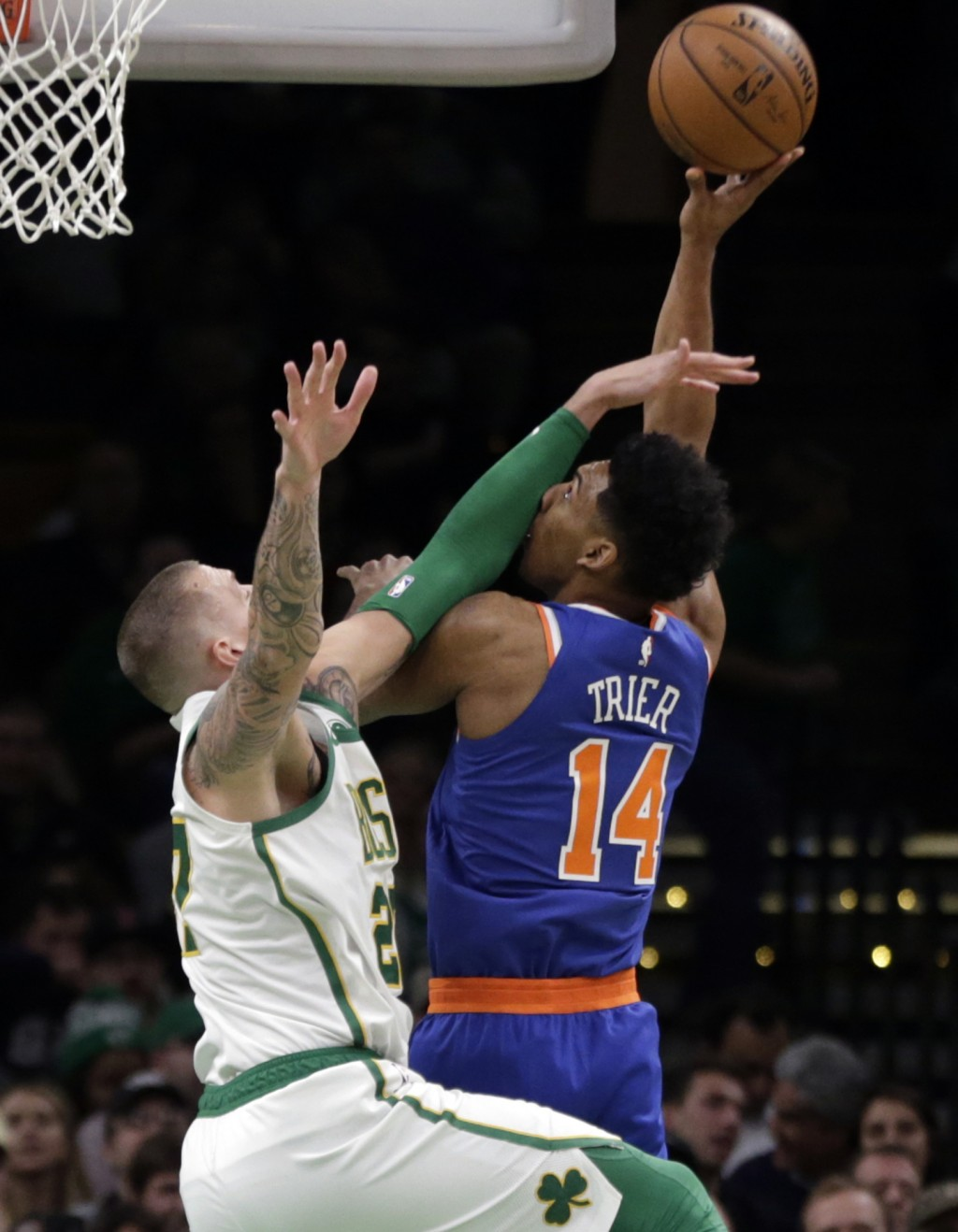 New York Knicks guard Allonzo Trier (14) tries to shoot over Boston Celtics forward Daniel Theis (27) during the first quarter of an NBA basketball ga