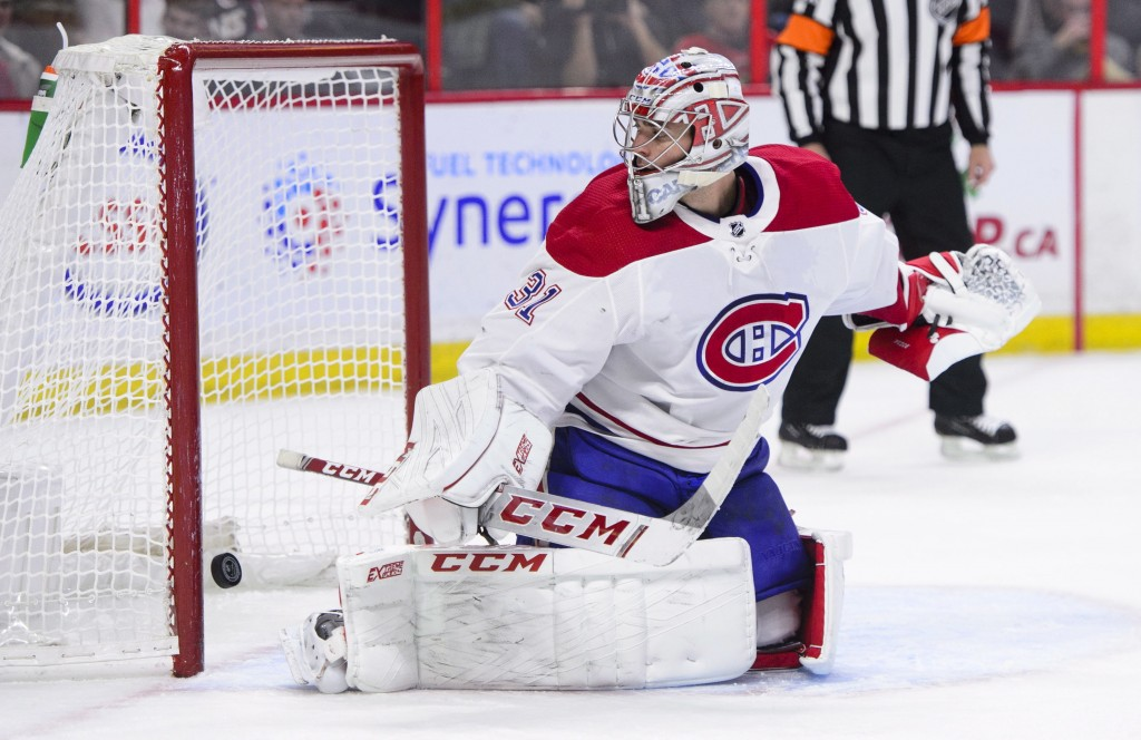 Montreal Canadiens goaltender Carey Price (31) allows a goal during first-period NHL hockey game action against the Ottawa Senators in Ottawa, Ontario