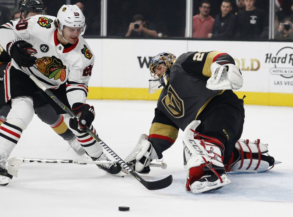 Chicago Blackhawks left wing Brandon Saad (20) attempts a shot against Vegas Golden Knights goaltender Marc-Andre Fleury (29) during the first period