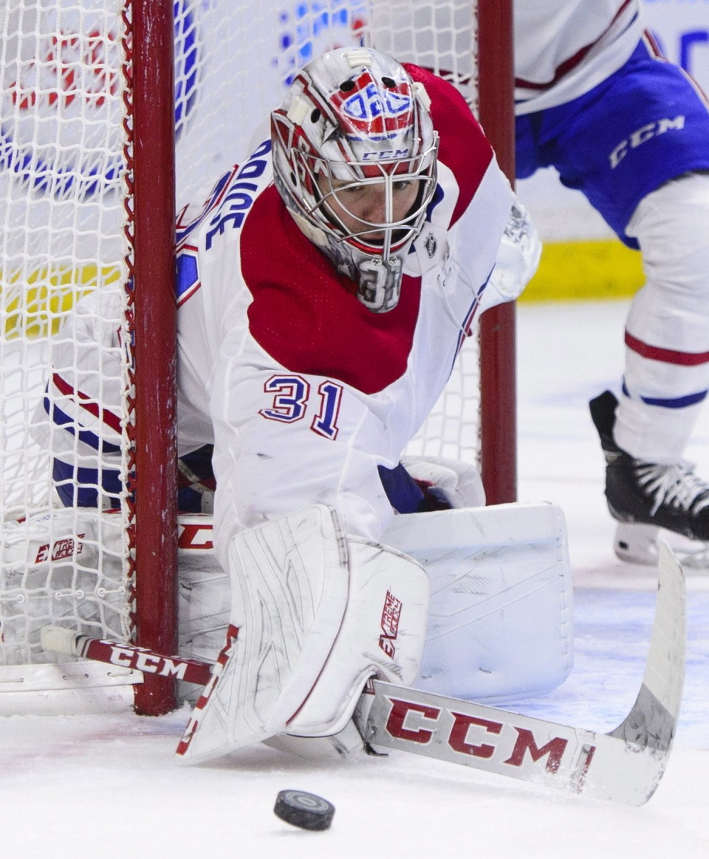 Montreal Canadiens goaltender Carey Price (31) deflects the puck during first-period NHL hockey game action against the Ottawa Senators in Ottawa, Ont