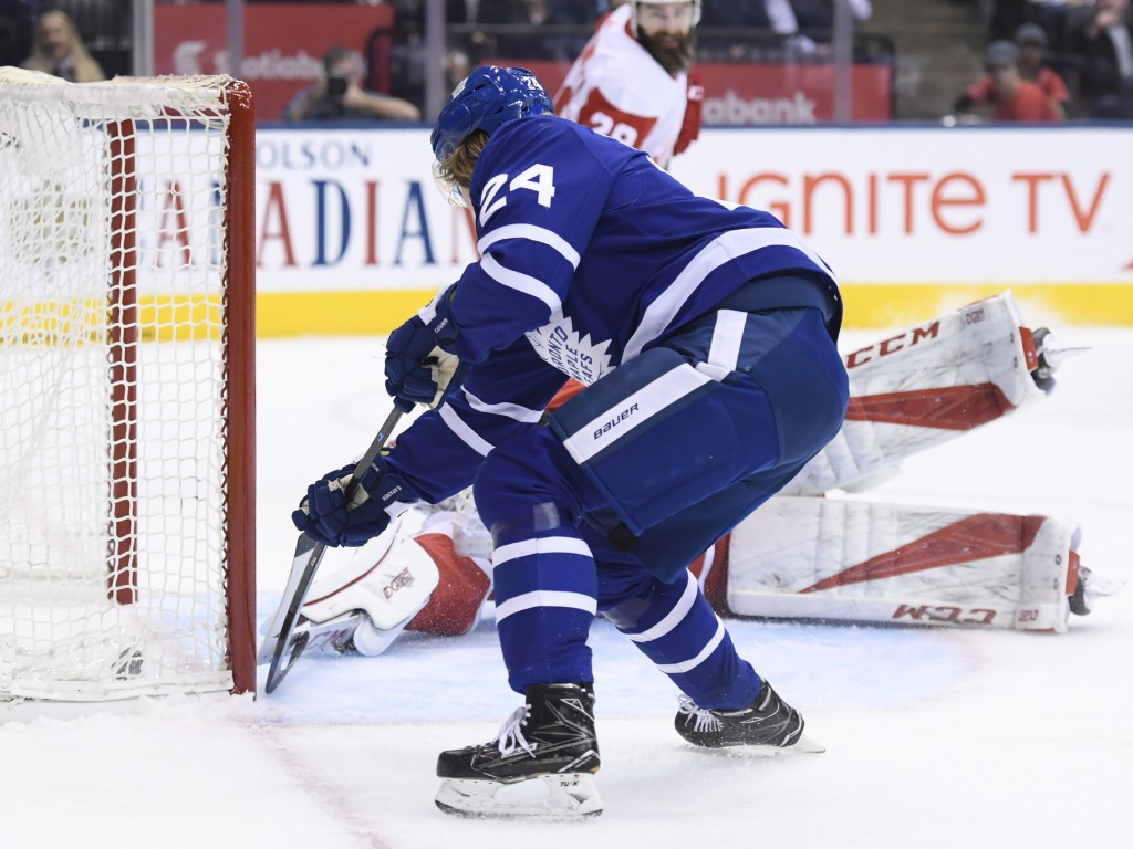 Toronto Maple Leafs right wing Kasperi Kapanen (24) scores past Detroit Red Wings goaltender Jonathan Bernier (45) during the first period of an NHL h