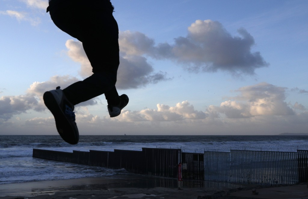 Resident Victor Jimenez practices his parkour skills on the beach near the U.S. border fence, in Tijuana, Mexico, on Friday, Nov. 30, 2018. Mexican au