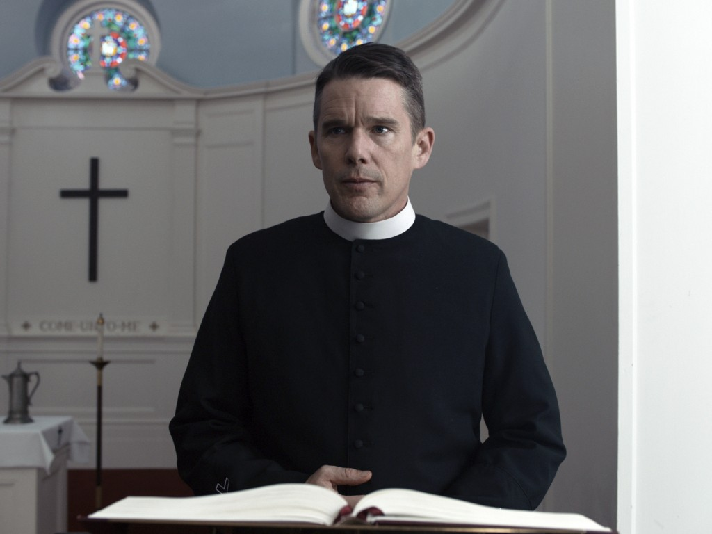 """This image released by A24 shows Ethan Hawke in a scene from """"First Reformed."""" Paul Schrader's punishing drama about a protestant minister got a handf"""