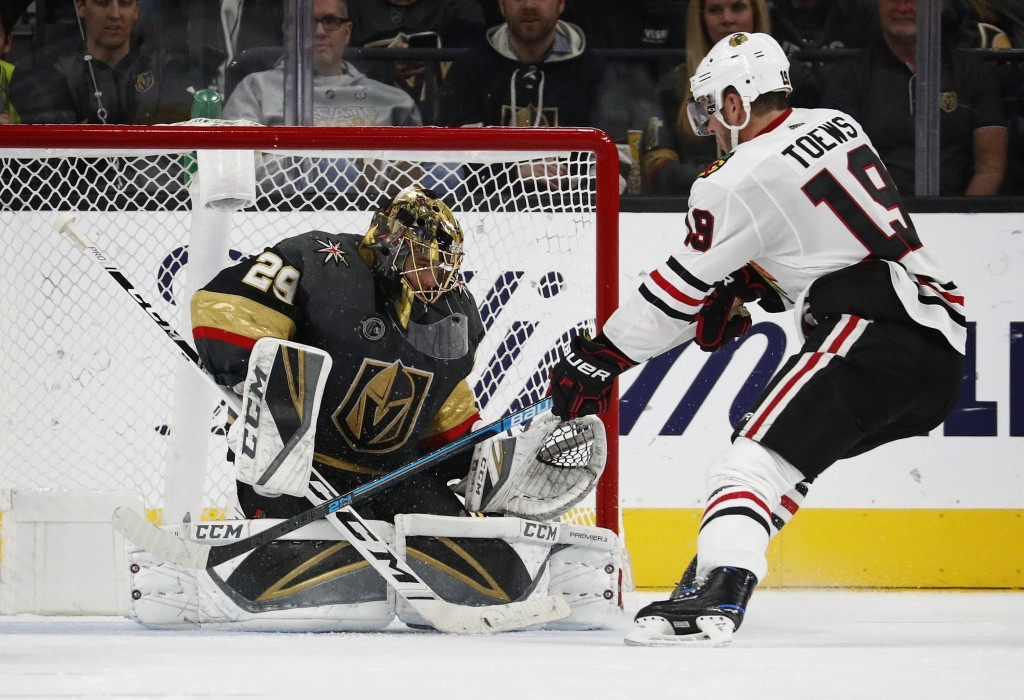 Vegas Golden Knights goaltender Marc-Andre Fleury (29) blocks a shot by Chicago Blackhawks center Jonathan Toews (19) during the second period of an N