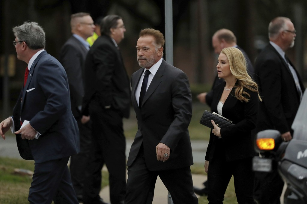 Former California Gov. Arnold Schwarzenegger arrives at a funeral for former President George H.W. Bush at St. Martin's Episcopal Church Thursday, Dec