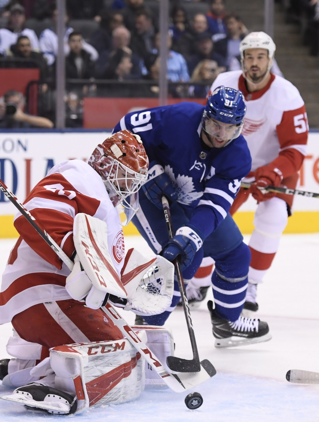 Toronto Maple Leafs center John Tavares (91) is stopped by Detroit Red Wings goaltender Jonathan Bernier (45) as Red Wings defenseman Jonathan Ericsso