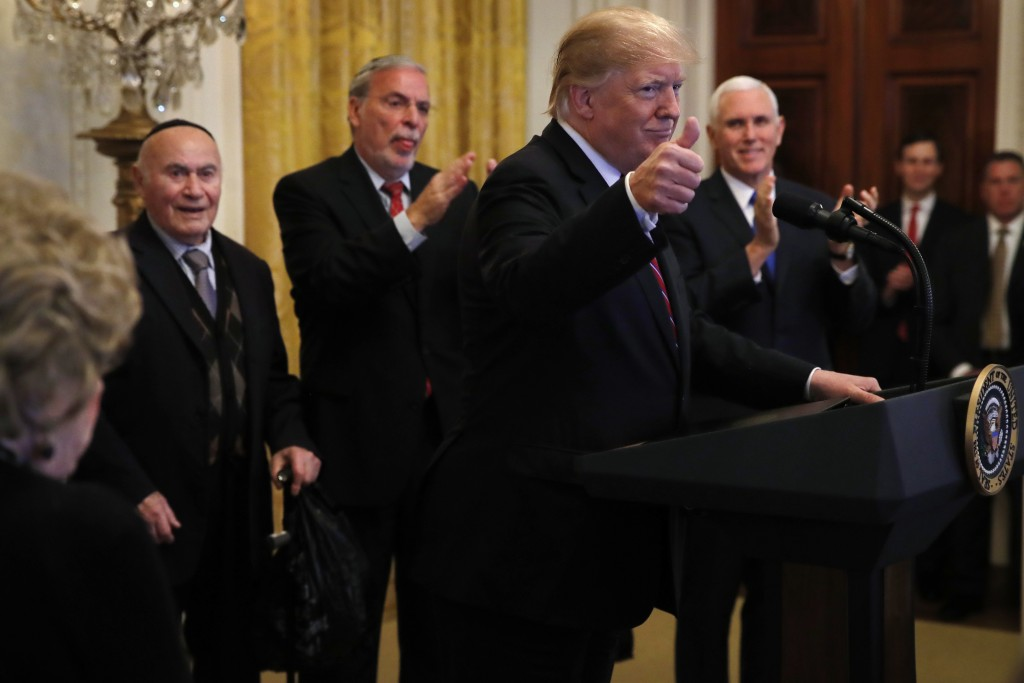 President Donald Trump makes the thumbs up sign as he speaks during a Hanukkah reception, Thursday, Dec. 6, 2018, in the East Room of the White House