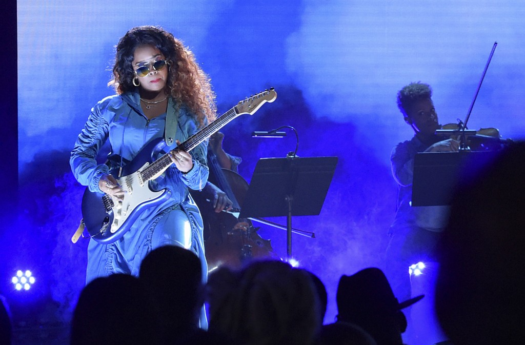 FILE - In this June 24, 2018 file photo, H.E.R. performs at the BET Awards at the Microsoft Theater in Los Angeles. A list of nominees in the top cate