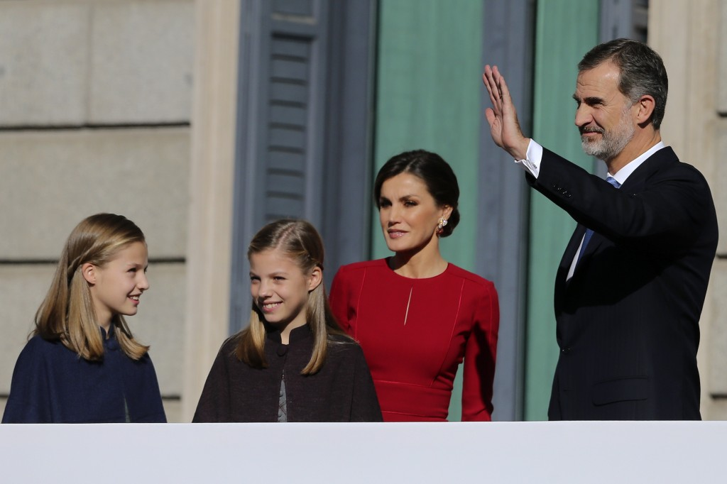 Spain's King Felipe VI and his wife Queen Letizia wave to the crowd with their daughters Princess Leonor, left, and Princess Sofia after their arrival