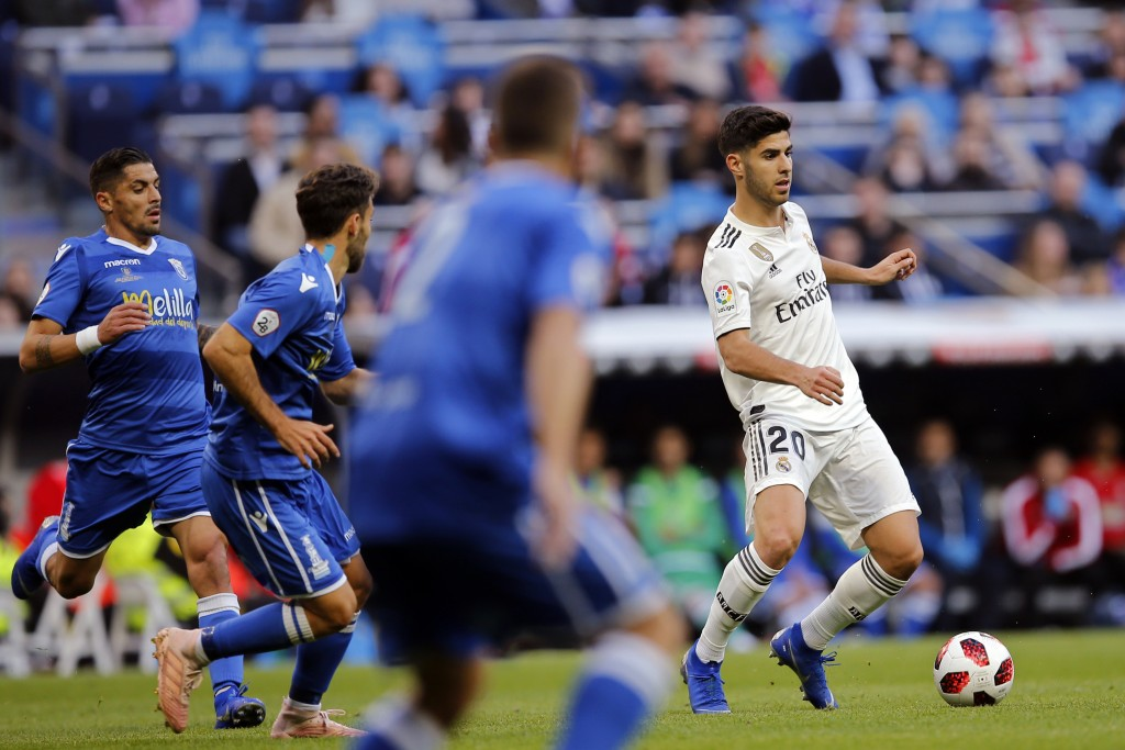 Real Madrid's Marco Asensio, right, controls the ball during a round of 32, 2nd leg, Spanish Copa del Rey soccer match between Real Madrid and Melilla