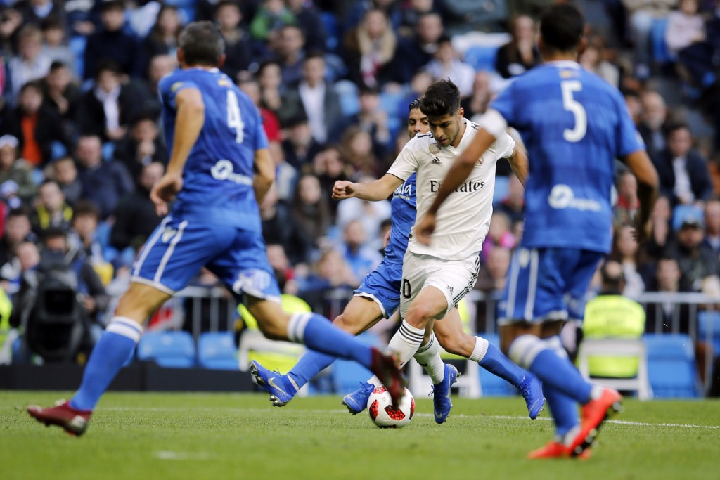 Real Madrid's Marco Asensio prepares to shoot to score the opening goal during a round of 32, 2nd leg, Spanish Copa del Rey soccer match between Real