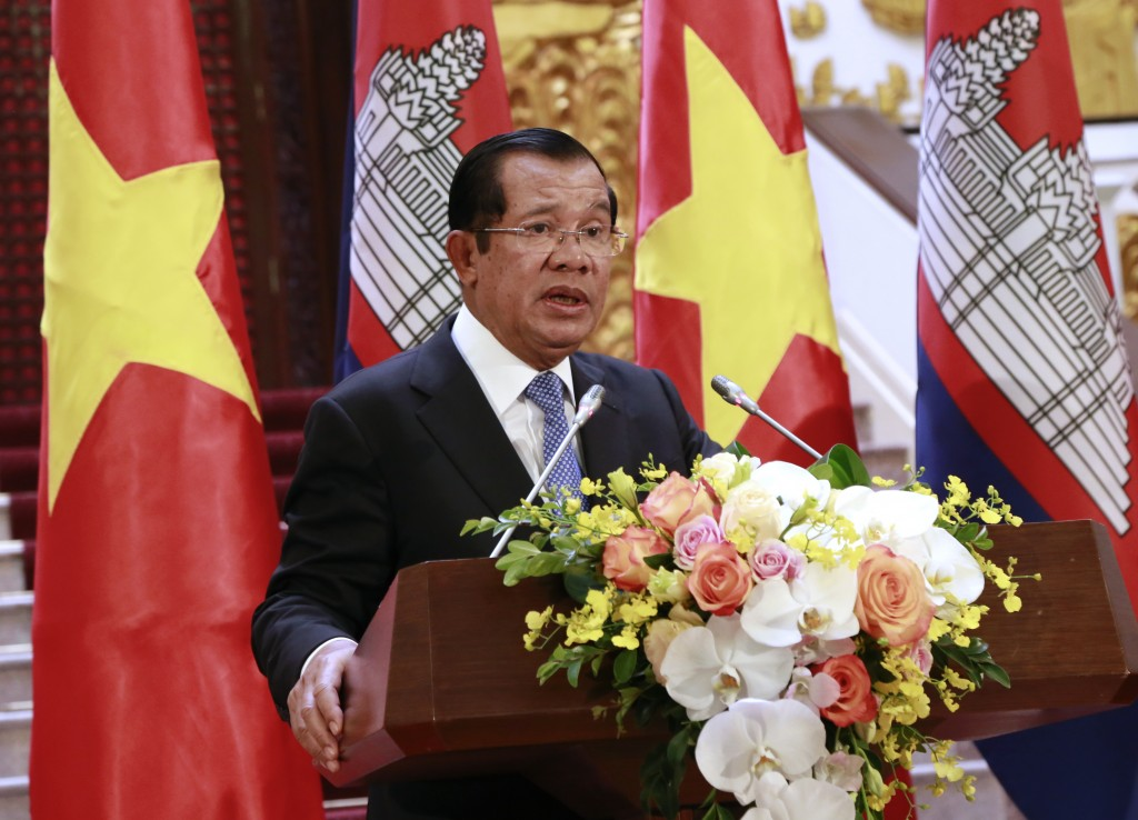 Cambodian Prime Minister Hun Sen speaks to reporters during a joint press briefing with his Vietnamese counterpart Nguyen Xuan Phuc in Hanoi, Vietnam
