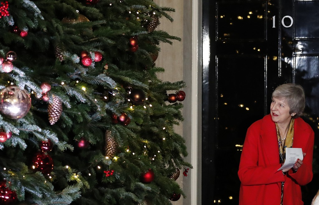 Britain's Prime Minister Theresa May attends the ceremony to light up a Christmas tree at 10 Downing Street in London Thursday Dec. 6 2018. (AP Pho