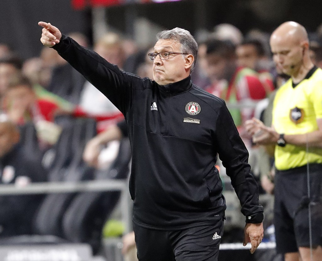 FILE - In this Nov. 25, 2018, file photo, Atlanta United head coach Gerardo Tata Martino directs his players in a MLS soccer playoff game against the