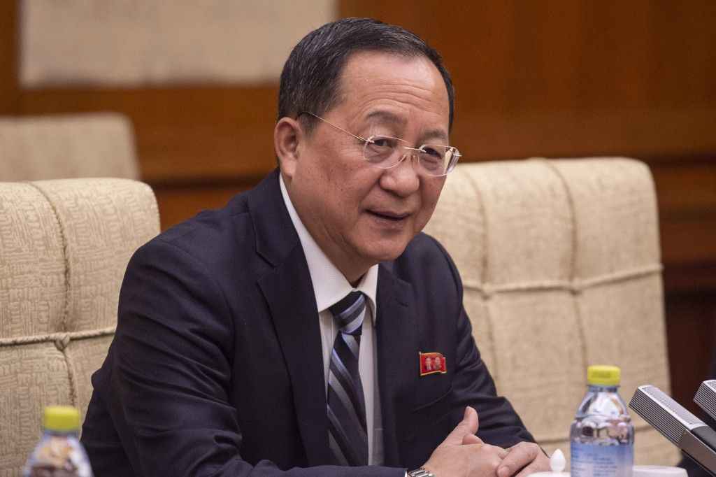 North Korean Foreign Minister Ri Yong Ho speaks to China's Foreign Minister Wang Yi during a meeting at the Diaoyutai State Guesthouse in Beijing  Fri