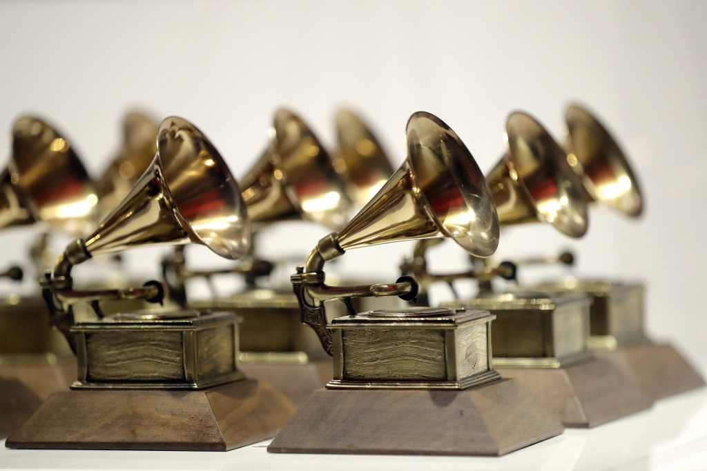 FILE - In this Oct. 10, 2017, file photo, various Grammy Awards are displayed at the Grammy Museum Experience at Prudential Center in Newark, N.J. Nom