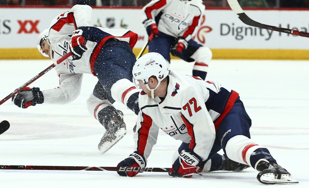 Washington Capitals center Travis Boyd (72) and center Nic Dowd, left, collide during the first period of the team's NHL hockey game against the Arizo