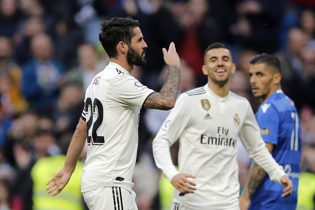 Real Madrid's Isco, left celebrates after scoring his side's fourth goal during a round of 32, 2nd leg, Spanish Copa del Rey soccer match between Real
