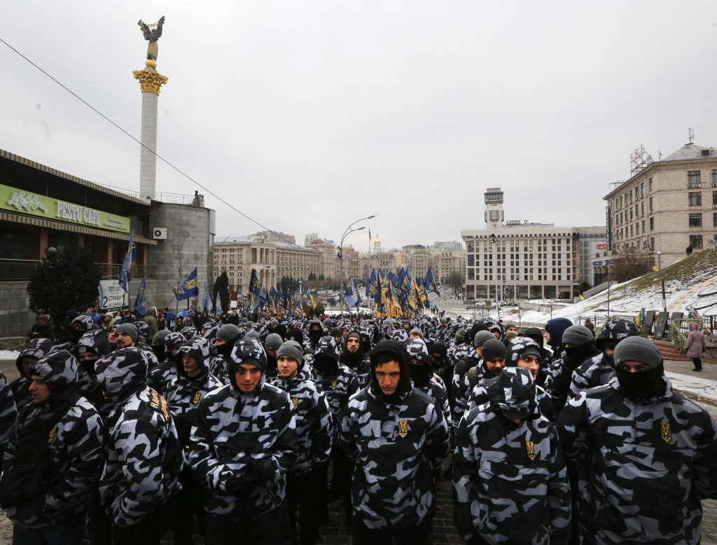 Volunteers with the right-wing paramilitary Azov National Corps attend a rally against Russia in front of the Ukrainian President's office in Kiev, Uk