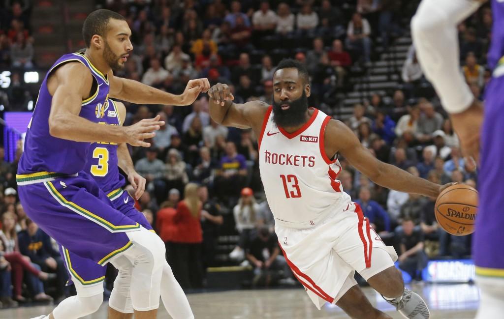 Houston Rockets guard James Harden (13) drives aro...
