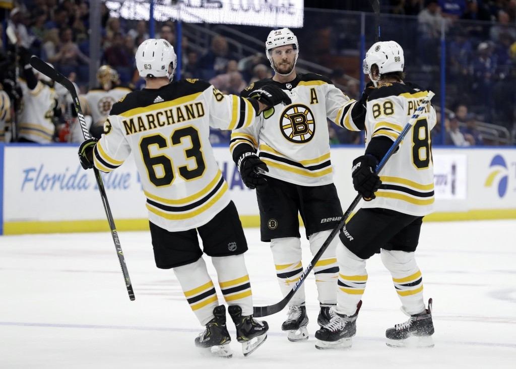Boston Bruins center David Krejci (46) celebrates his goal against the Tampa Bay Lightning with left wing Brad Marchand (63) and right wing David Past