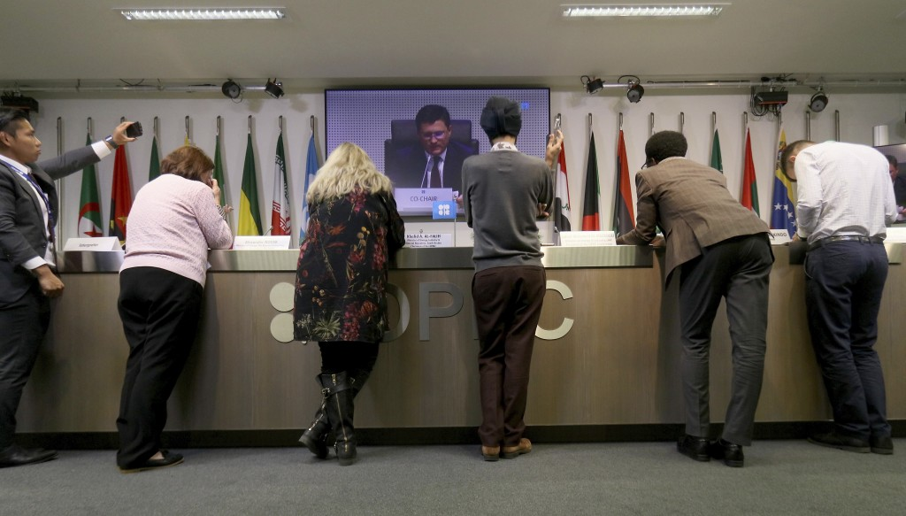 Journalists listen to a video during a meeting of the Organization of the Petroleum Exporting Countries, OPEC, and non OPEC members, at their headquar