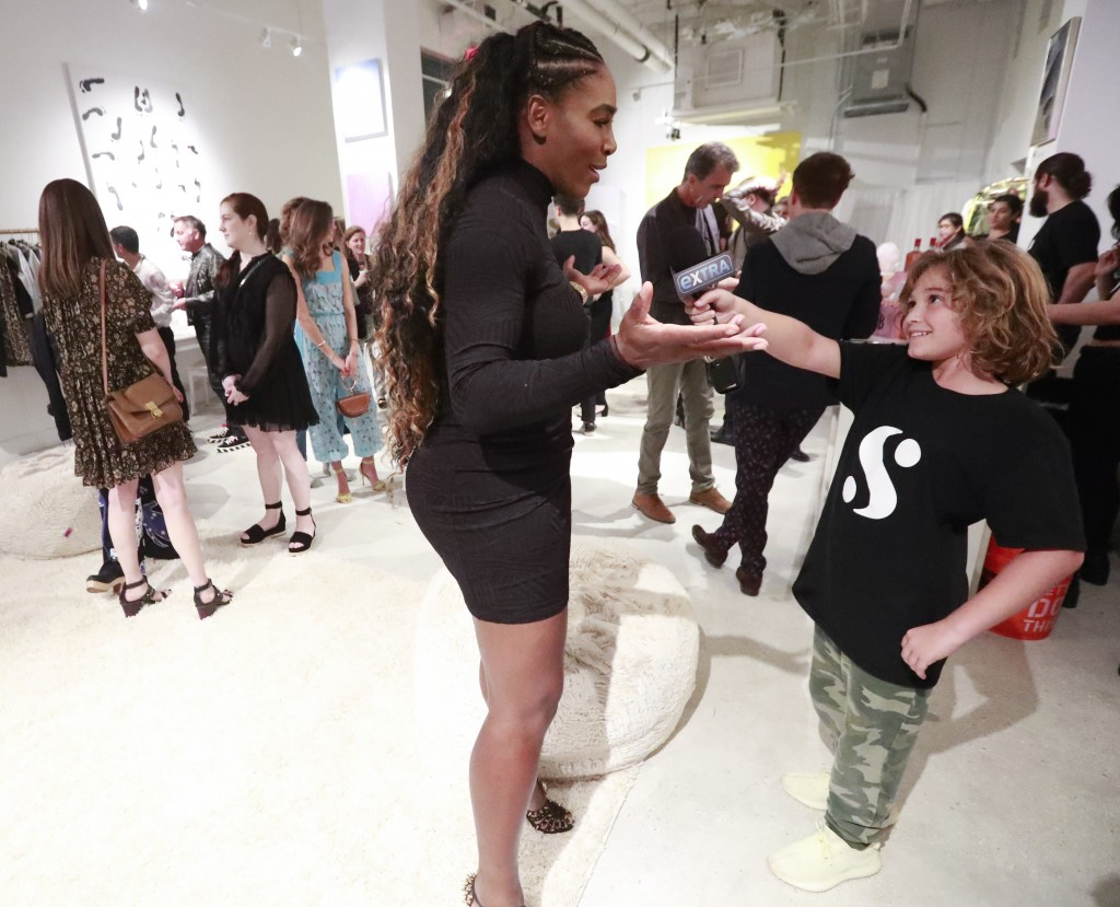 In this, Wednesday, Dec. 5, 2018 photo, Lucas Bacardi-Shriftman, 10, takes a go at interviewing tennis player Serena Williams during the launch of her