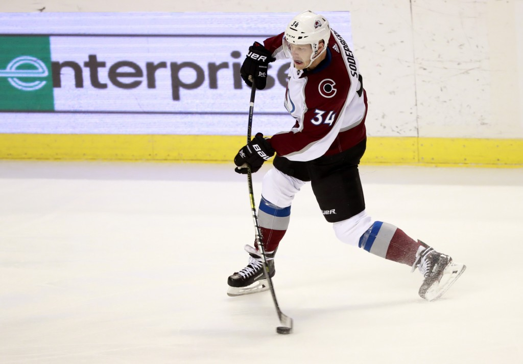 Colorado Avalanche center Carl Soderberg shoots to score a goal during the second period of an NHL hockey game against the Florida Panthers, Thursday,