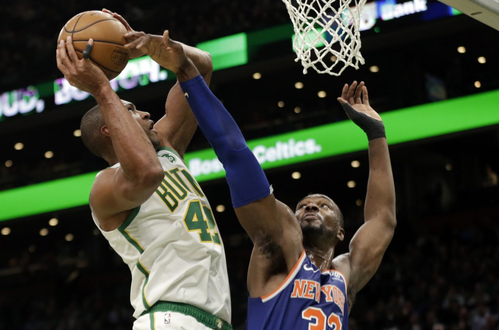 Boston Celtics center Al Horford (42) is defended by New York Knicks forward Noah Vonleh (32) during the second quarter of an NBA basketball game Thur
