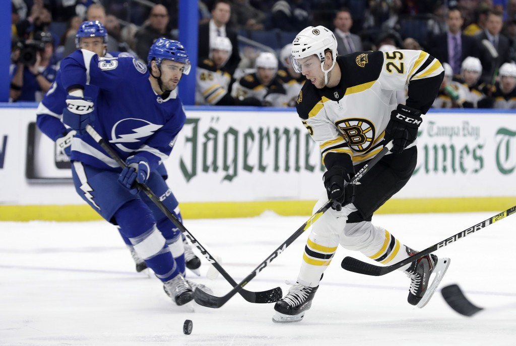 Boston Bruins defenseman Brandon Carlo (25) steals a pass intended for Tampa Bay Lightning center Cedric Paquette (13) during the first period of an N