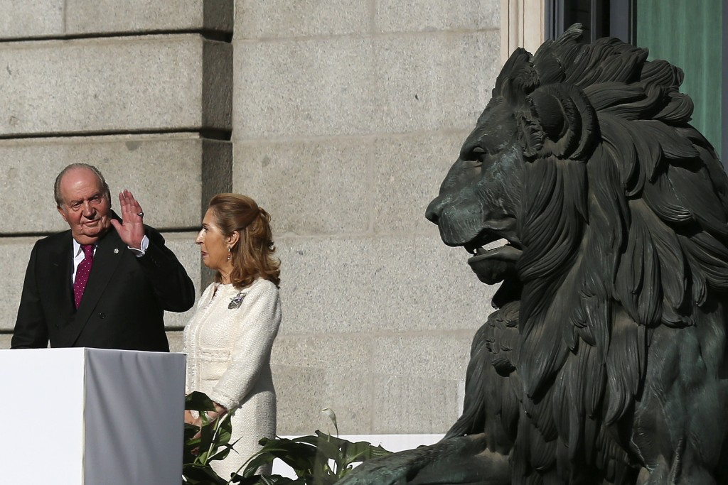 Spain's former King Juan Carlos waves to the crowd next to Spain's parliament speaker Ana Pastor after celebrations of the 40th anniversary of the Spa
