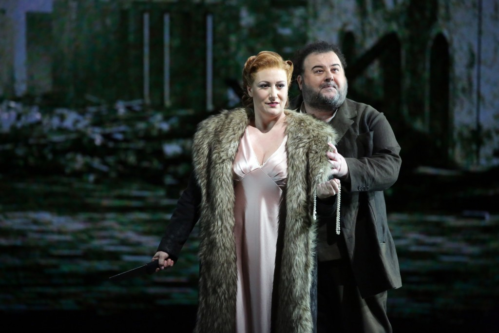 This undated photo made available by La Scala opera theater on Dec. 5, 2018 shows Spanish soprano Saioa Hernandez, on the ground, and Italian tenor Fa