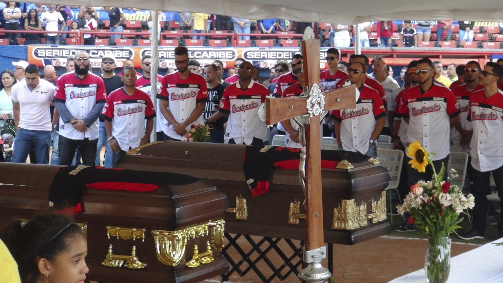 The caskets with the bodies of former major league baseball players Luis Valbuena and Jose Castillo are draped with their uniforms and surrounded by t