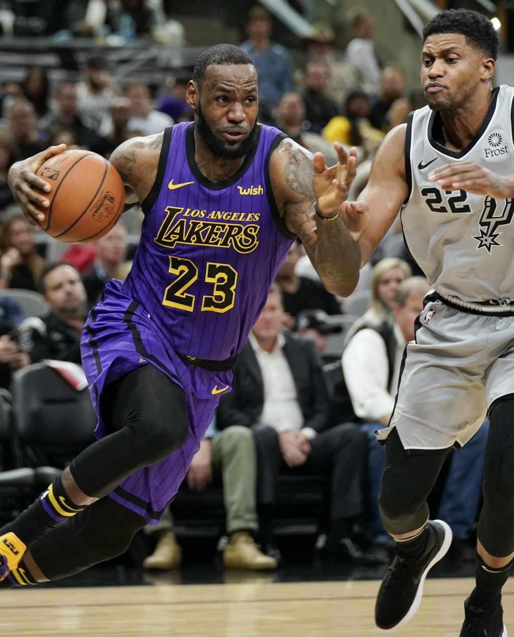 Los Angeles Lakers' LeBron James (23) drives around San Antonio Spurs' Rudy Gay during the first half of an NBA basketball game Friday, Dec. 7, 2018,