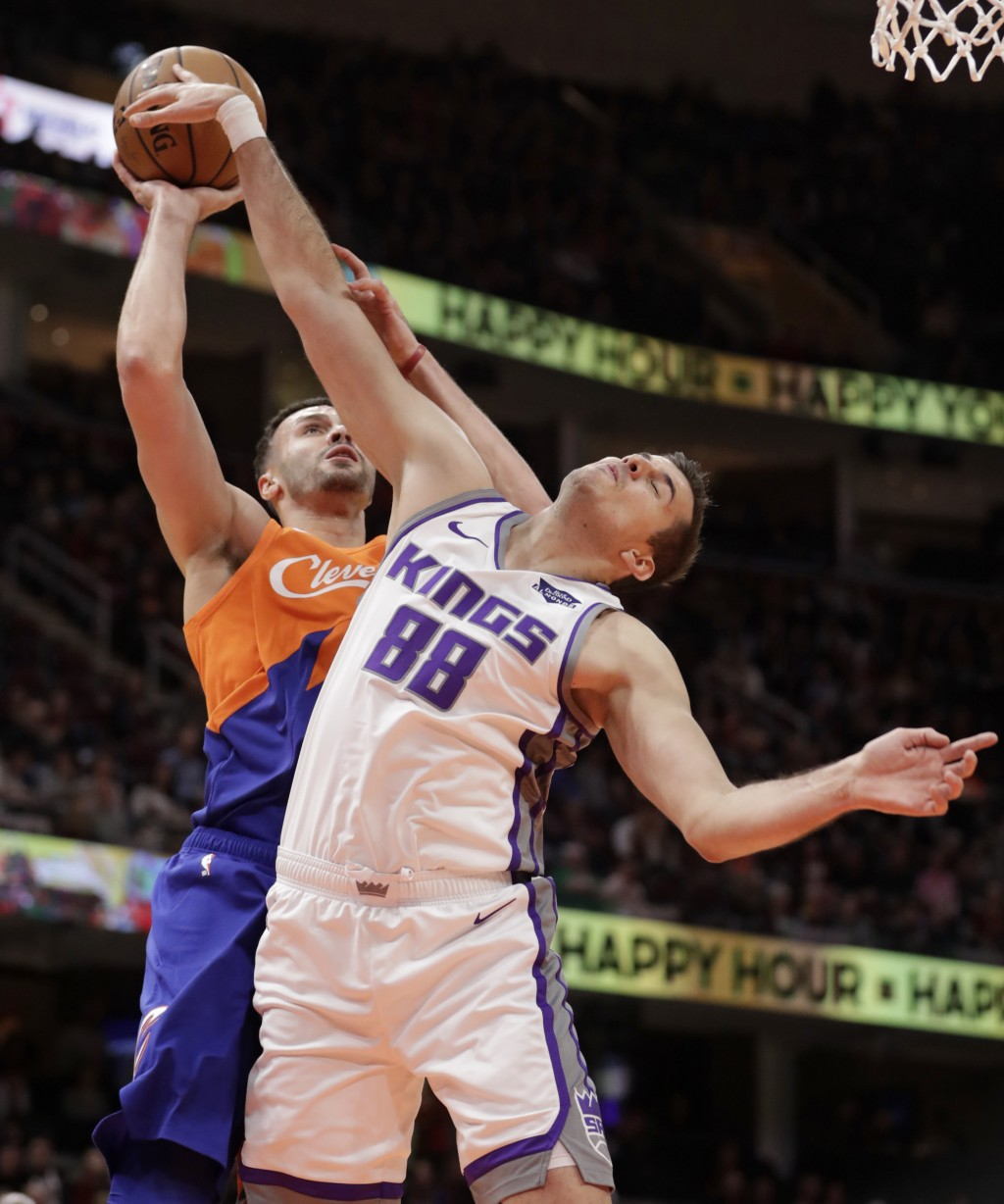 Sacramento Kings' Nemanja Bjelica (88), from Serbia, blocks a shot by Cleveland Cavaliers' Larry Nance Jr. (22) in the first half of an NBA basketball