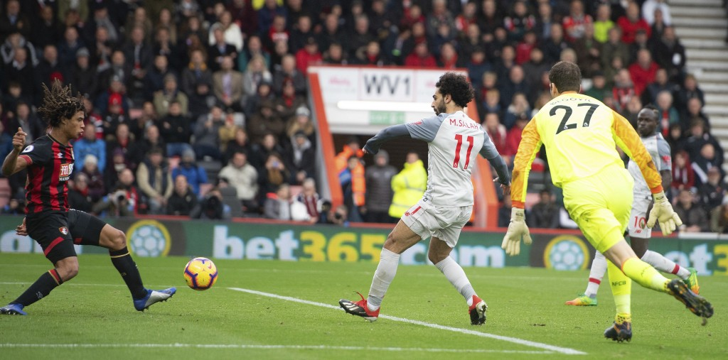 Liverpool's Mohamed Salah, right, scores his hat-trick goal during their English Premier League soccer match against Bournemouth at the Vitality Stadi