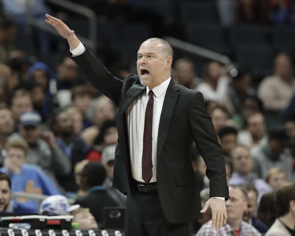 Denver Nuggets coach Michael Malone argues a call during the first half of the team's NBA basketball game against the Charlotte Hornets in Charlotte,