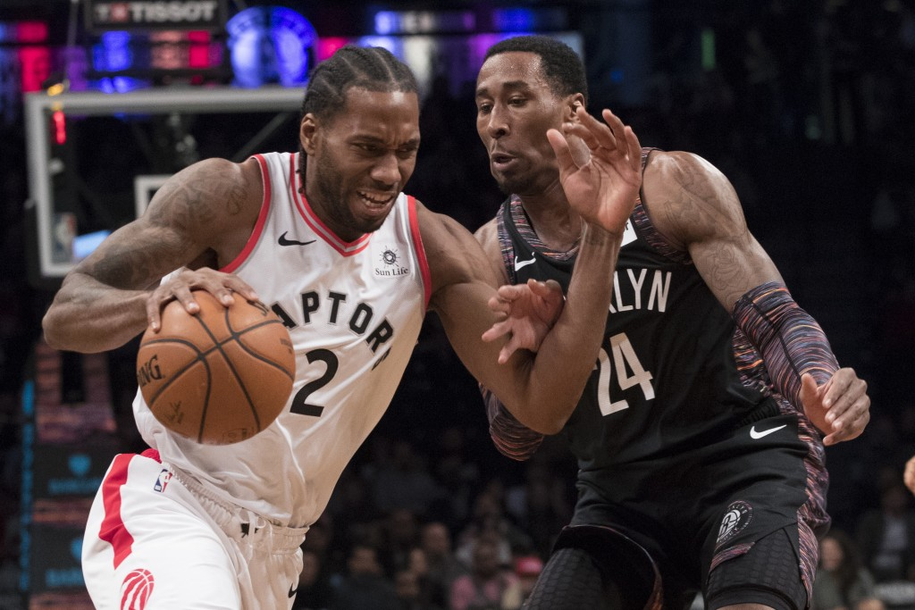 Toronto Raptors forward Kawhi Leonard (2) drives to the basket against Brooklyn Nets forward Rondae Hollis-Jefferson (24) during the first half of an