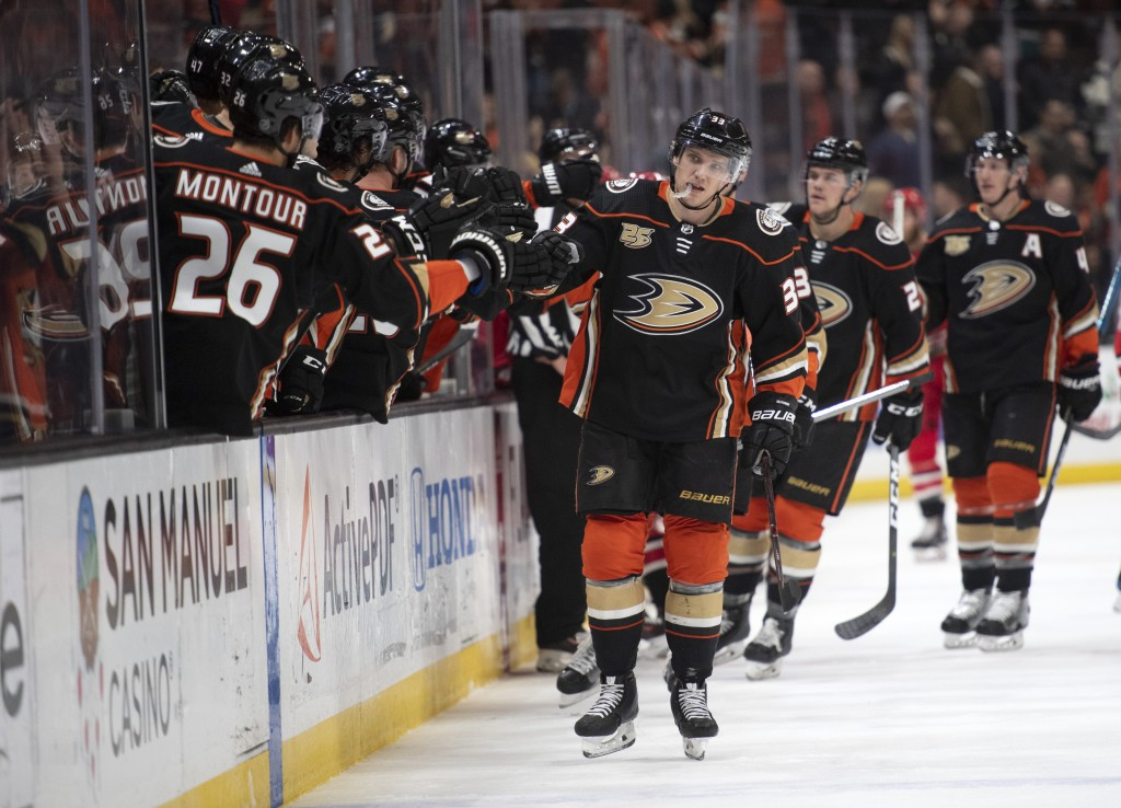 Anaheim Ducks right wing Jakob Silfverberg is congratulated after his first-period goal against the Carolina Hurricanes during an NHL hockey game in A