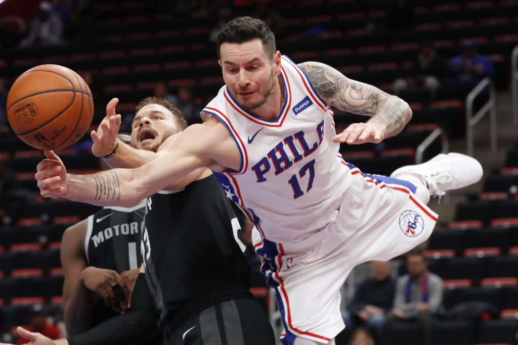 Philadelphia 76ers guard JJ Redick (17) is fouled by Detroit Pistons forward Blake Griffin (23) in the second half of an NBA basketball game in Detroi