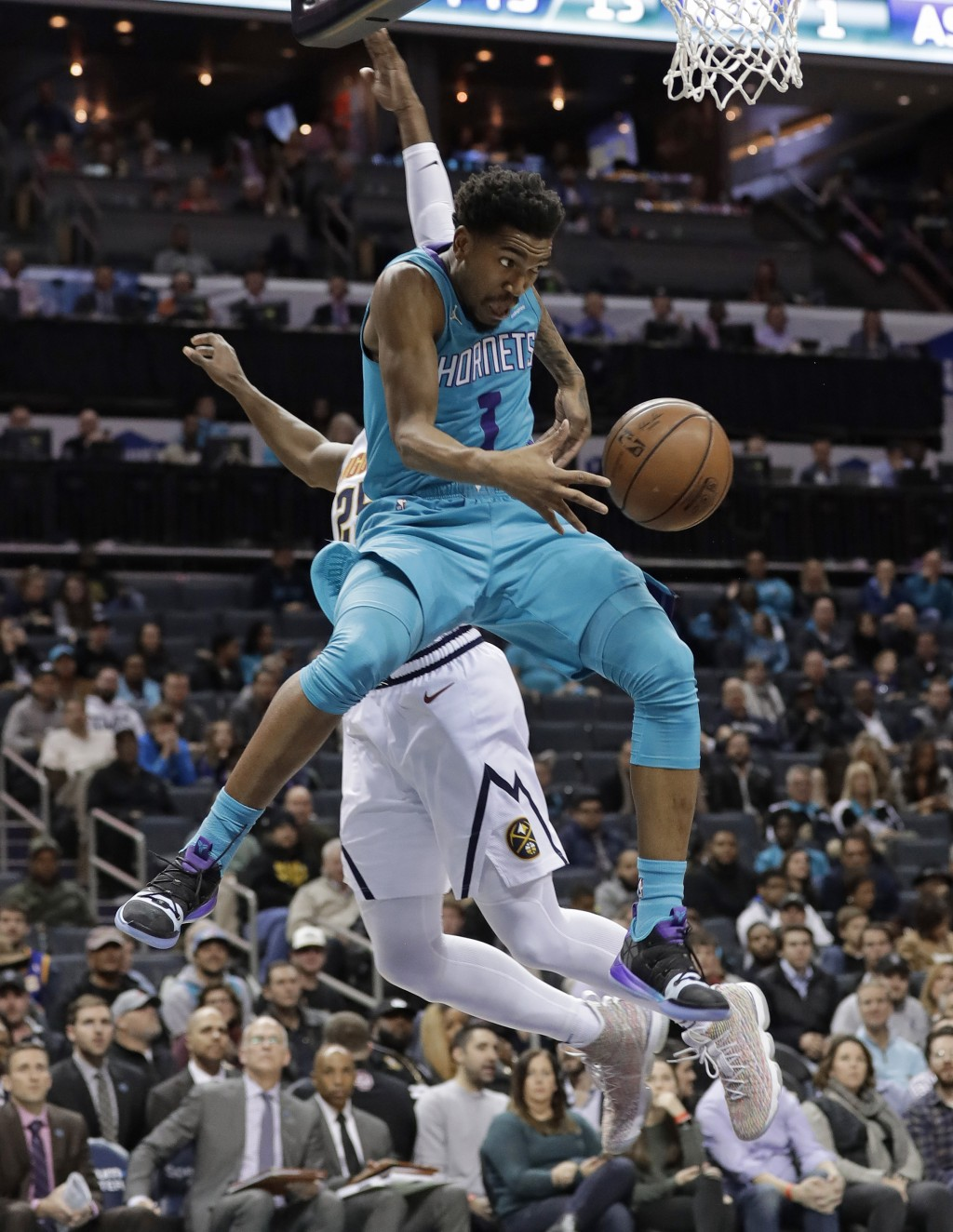 Charlotte Hornets' Malik Monk (1) passes the ball as Denver Nuggets' Malik Beasley defends during the first half of an NBA basketball game in Charlott