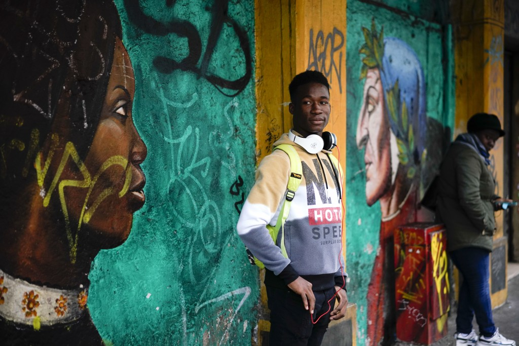 In this photo taken on Thursday, Dec. 6, 2018, Barry Tierno, 19, from Burkina Faso poses for a photo during an interview with The Associated Press, in