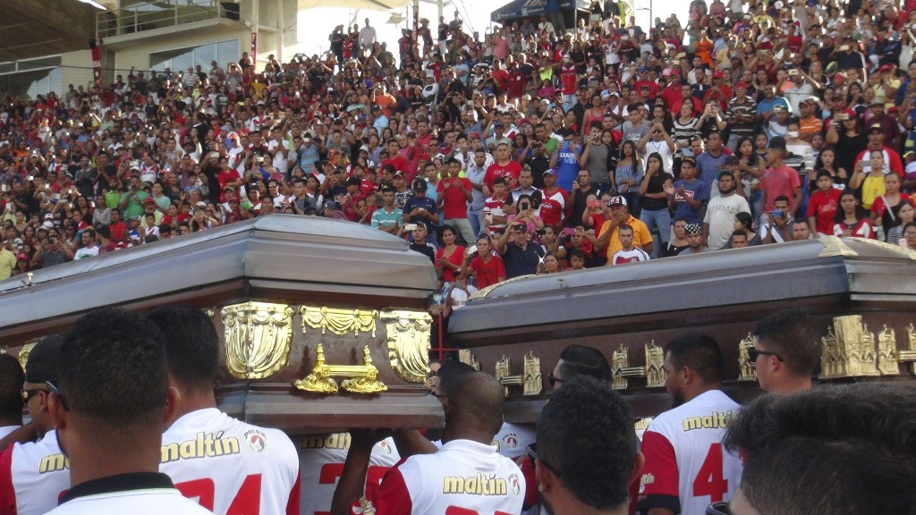 The caskets with the bodies of former major league baseball players Luis Valbuena and Jose Castillo are carried by fellow players on the team Cardenal