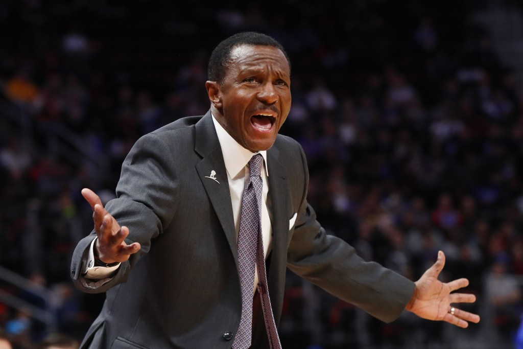 Detroit Pistons head coach Dwane Casey argues a call in the first half of an NBA basketball game  against the Philadelphia 76ers in Detroit, Friday, D
