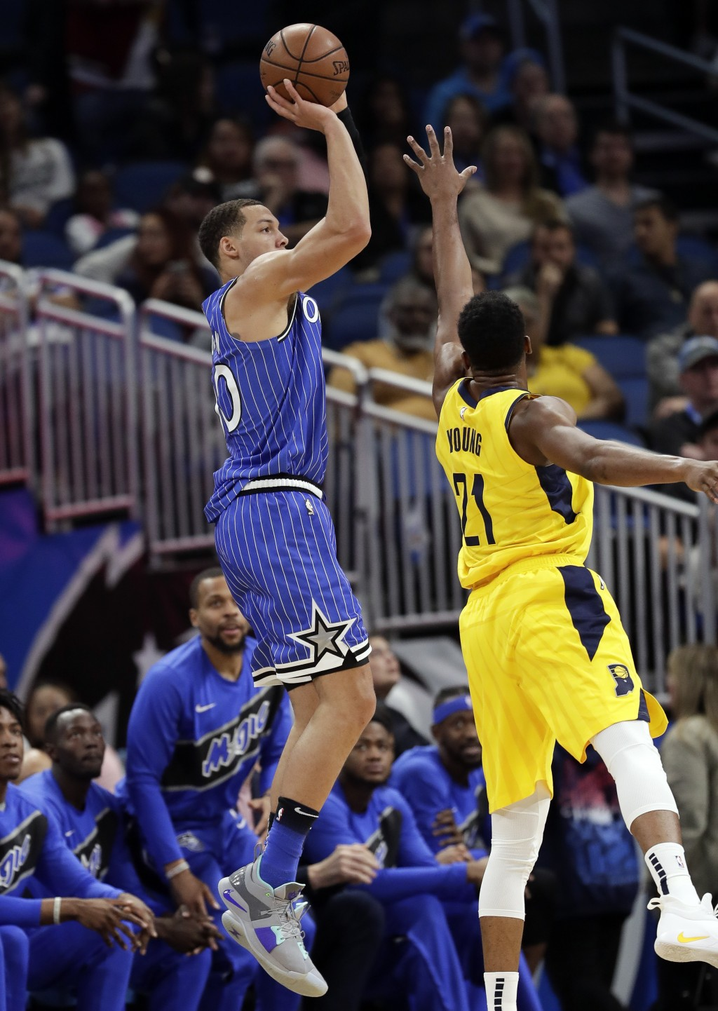 Orlando Magic's Aaron Gordon shoots over Indiana Pacers' Thaddeus Young (21) during the first half of an NBA basketball game Friday, Dec. 7, 2018, in ...